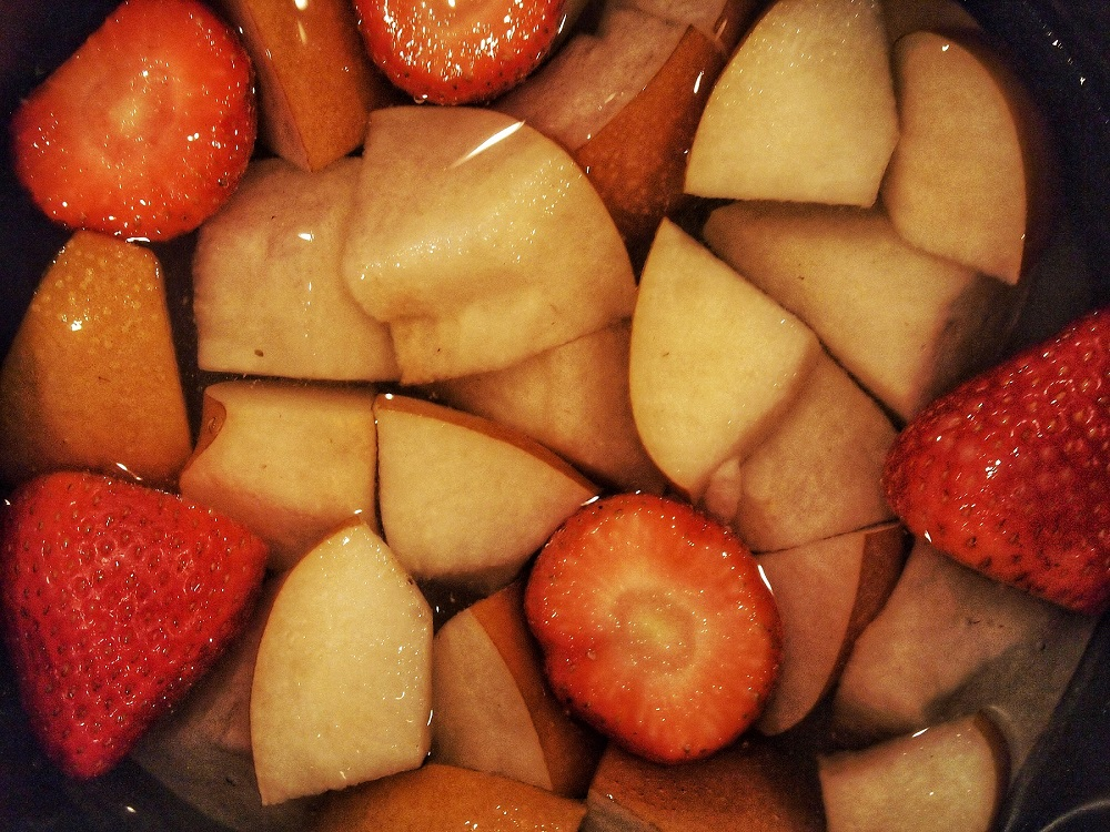 Pear and strawberry cooked to make the syrup and puree