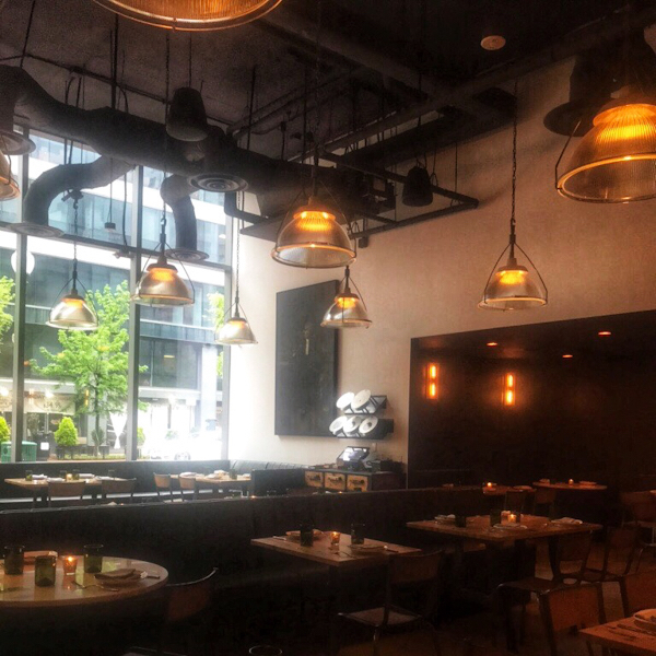 Nicoletta Italian Kitchen Inside the restaurant with floor to ceiling windows.