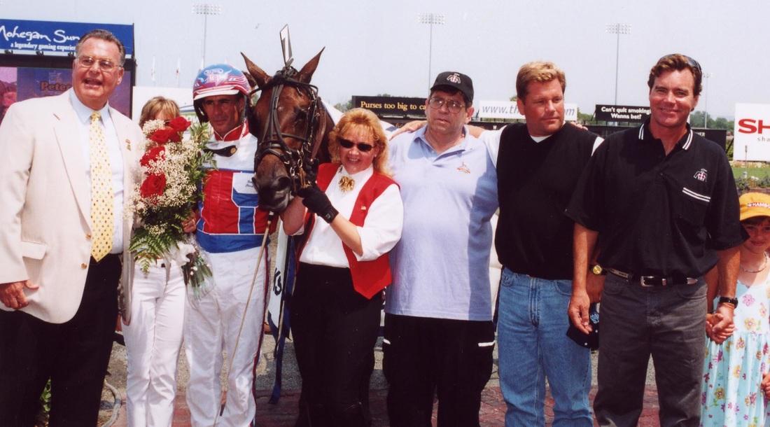 Keller family in winner circle with Windylane Hanover, 2002 Oaks winner