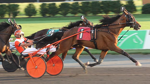 Overdraft Volo and driver Andy Miller score in the second division of the Del Miller Memorial at the Meadowlands Saturday night.
