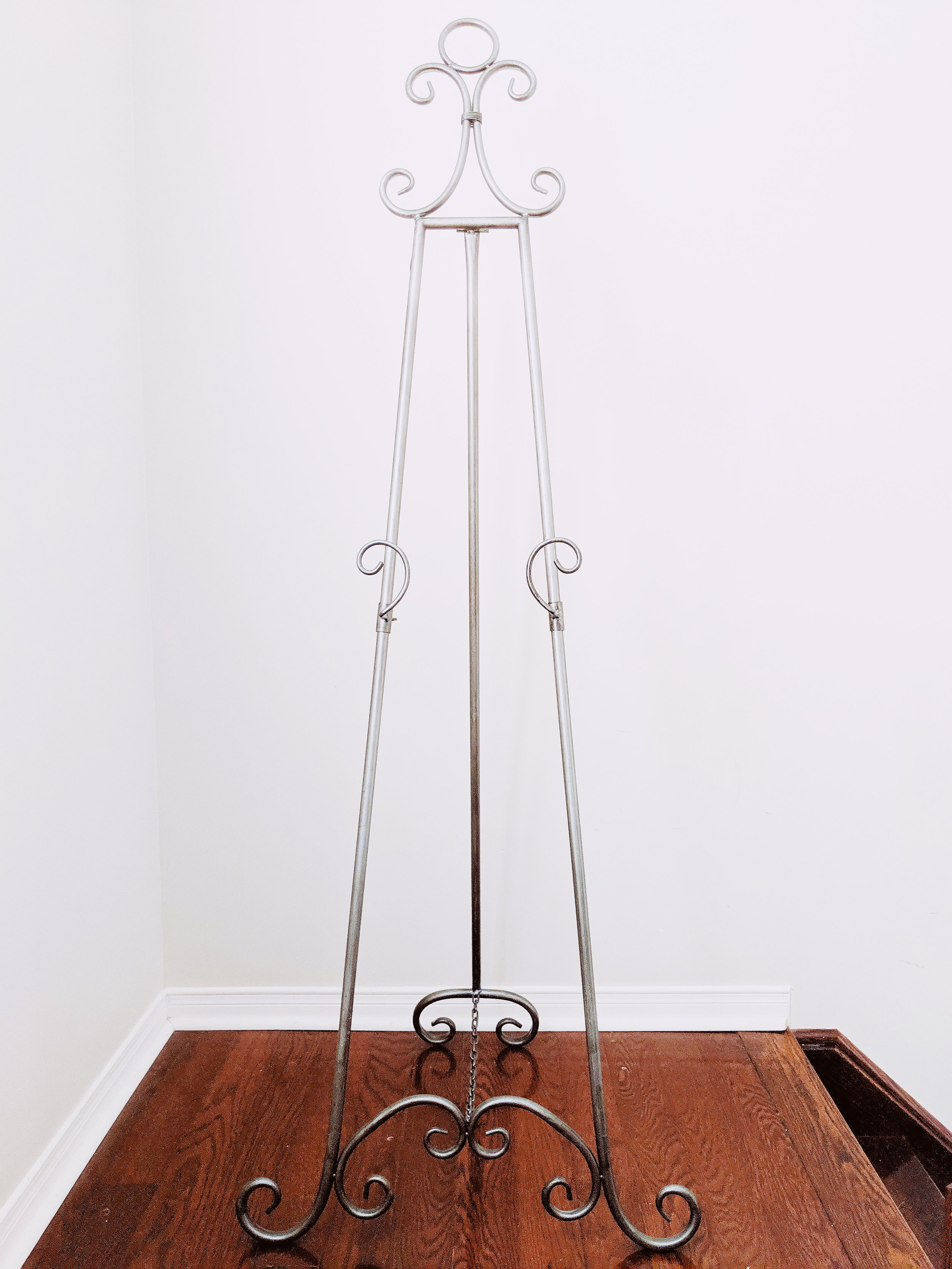 Floor Easel - Adjustable. Ideal for welcome sign in acrylic, mirror and wood.Rental Fee: $30; Security Deposit: $60