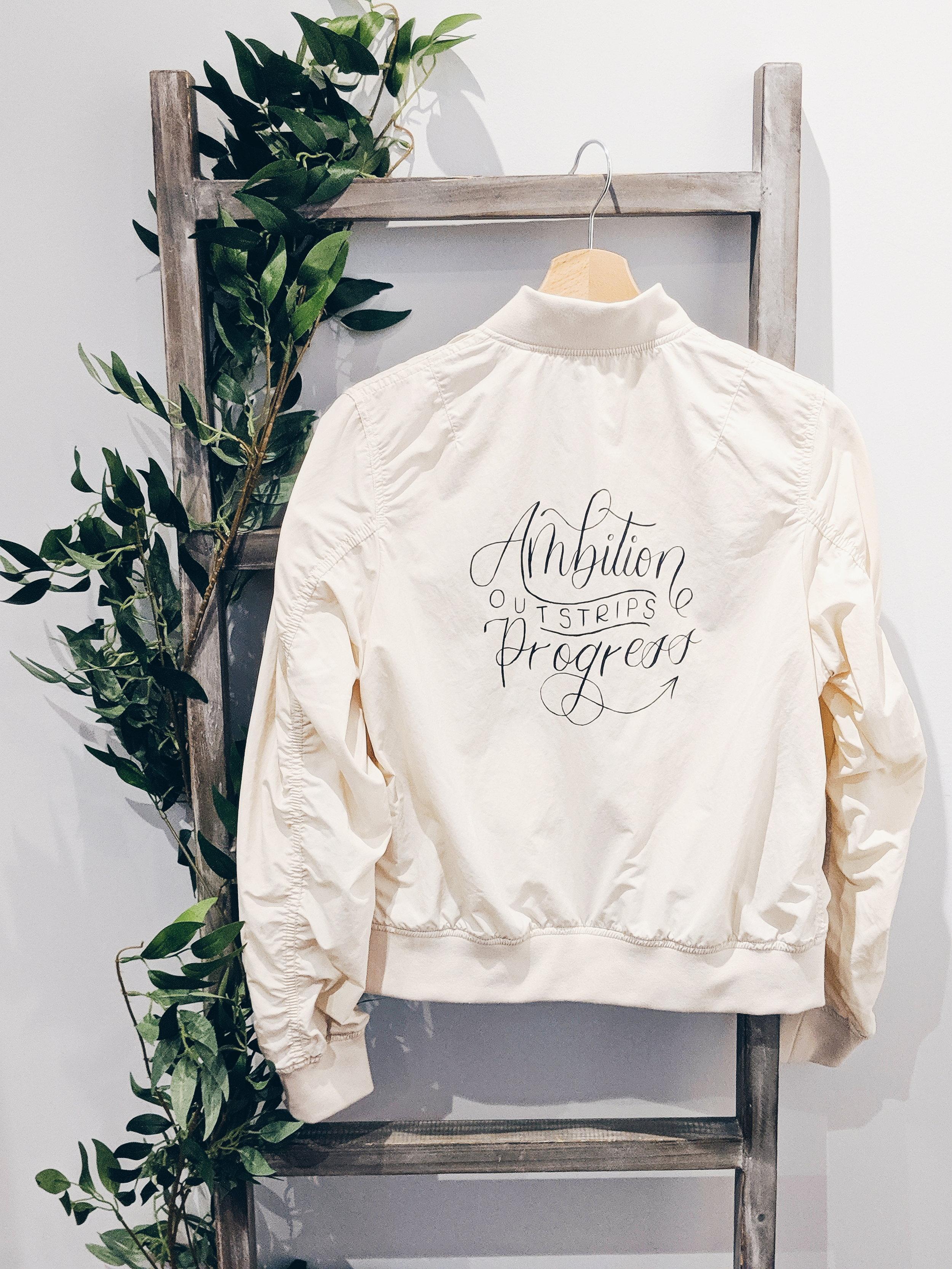Calligraphy on bomber jacket