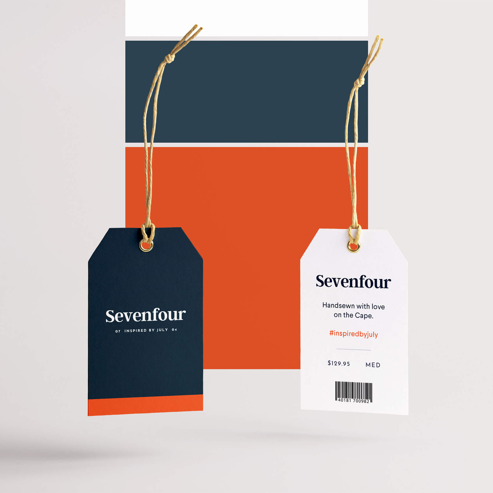 Branding and colorsClothing Tags for Sevenfour - Sevenfour's physical packaging draws on the brand's iconic navy, white, and blood orange red. Natural twine and gold eyelets ties everything back to the label's nautical roots on Cape Cod.