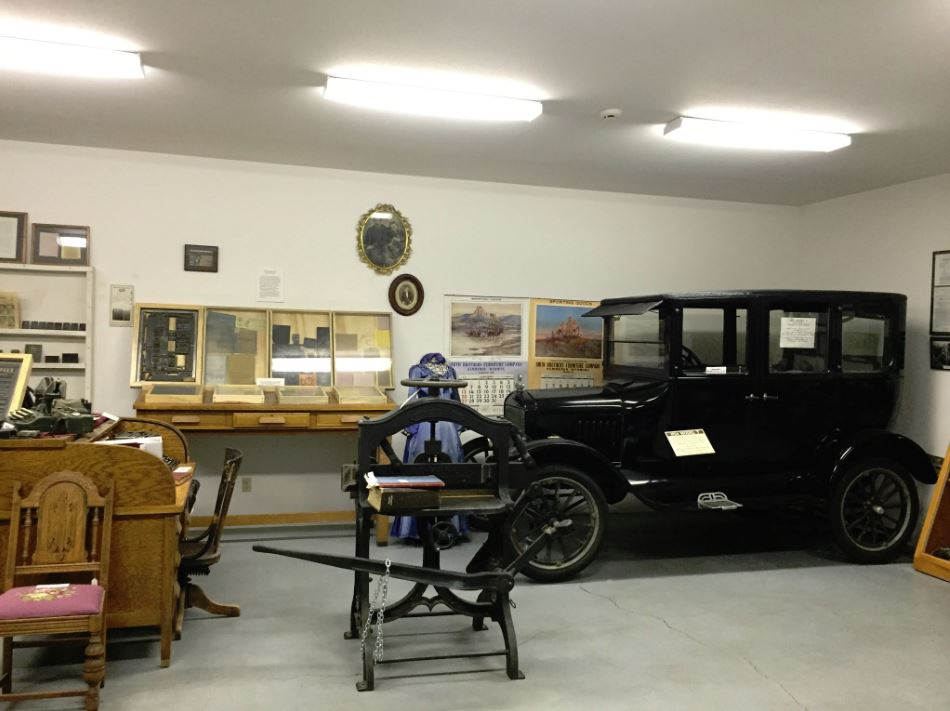 The classic early automobile alongside various items in the Model T Room