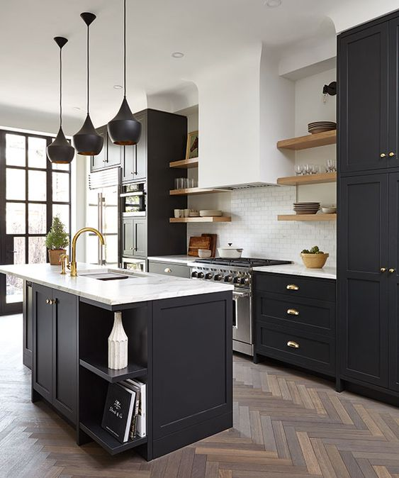 - Sure, a white kitchen looks sleek and clean, but look at this kitchen.The contrast between the black and white is so striking.