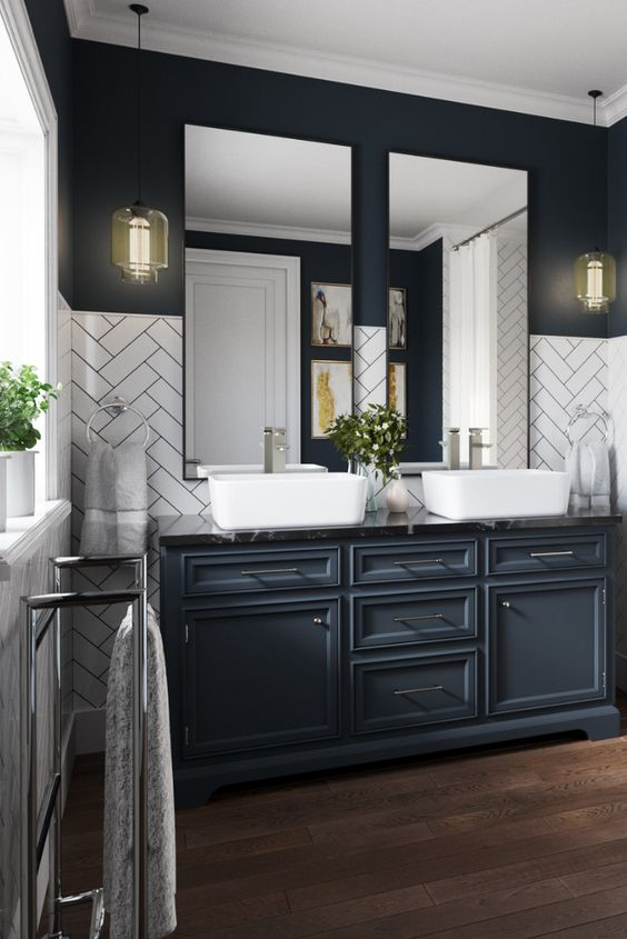 - Dark kitchens are more than just black and gray. They can be navy like the vanity in this restroom.