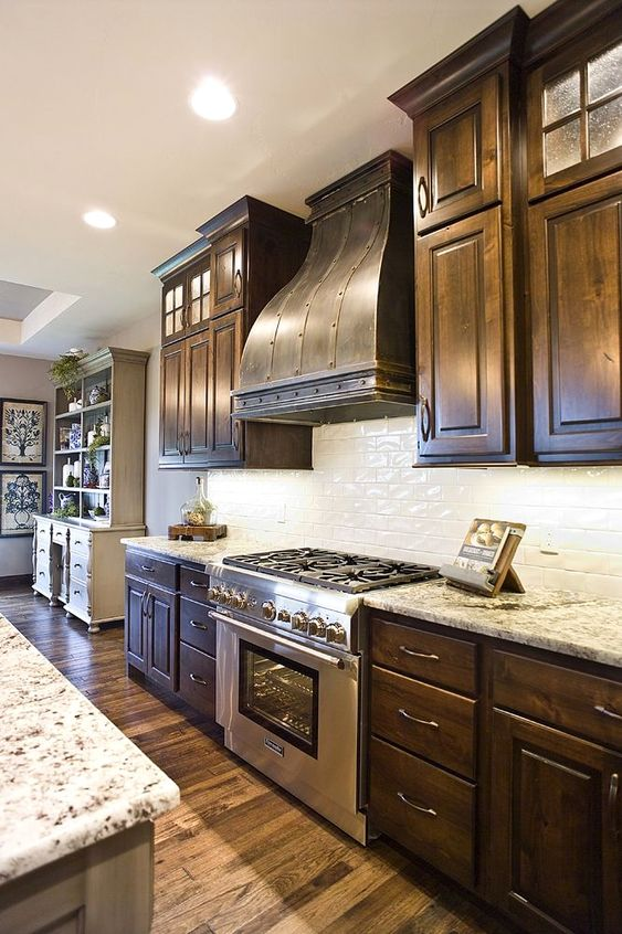 - Or they can be a warm happy brown like the cabinets in this home.And they can do more than just be in kitchens and bathrooms. Dark kitchens, you're just as cool as the whites and grays that everyone has been loving lately.