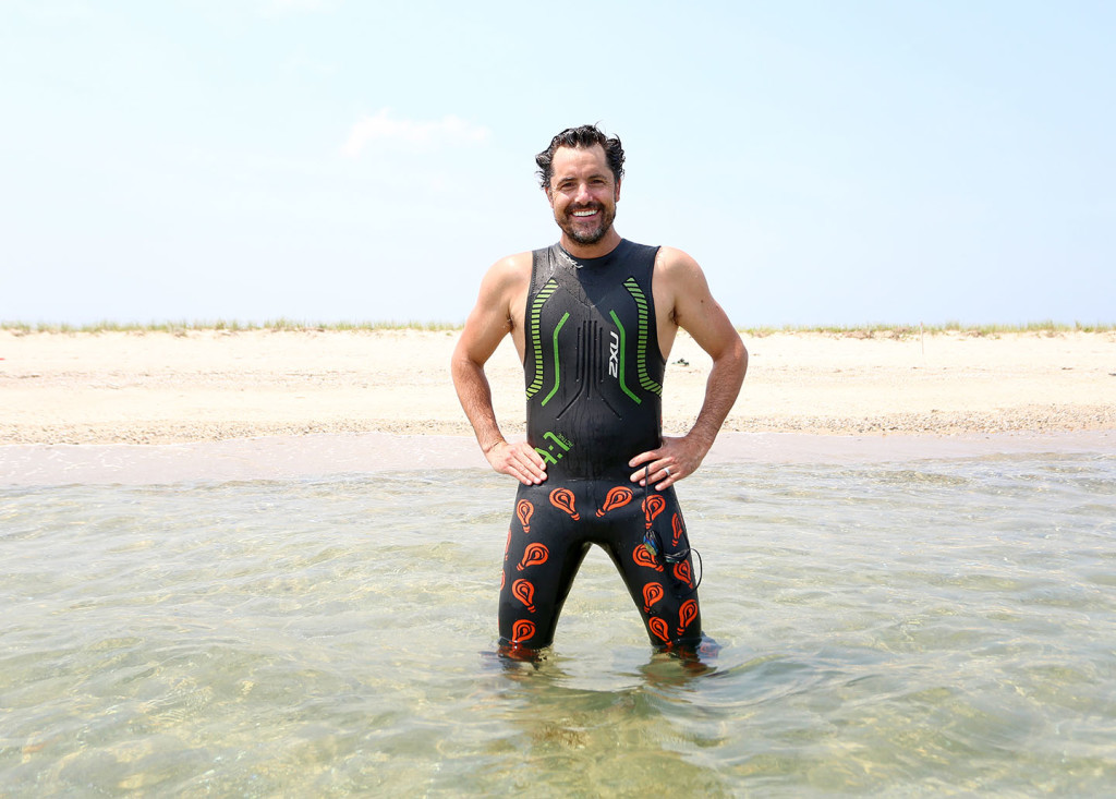 Dean Bragonier, who lives in Cambridge and on the Vineyard, will swim around the Island in a specially made suit designed to ward off sharks. – Photo by Michael Cummo
