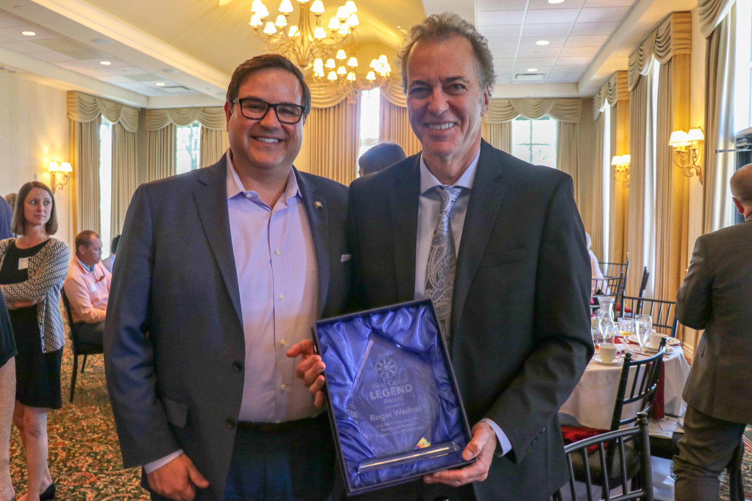 City of Lakewood Mayor Adam Paul, LEGEND Award Recipient Roger Wadnal and the Comprehensive Planning and Research Division at the City of Lakewood at the 5th Annual West Colfax Lately Luncheon.