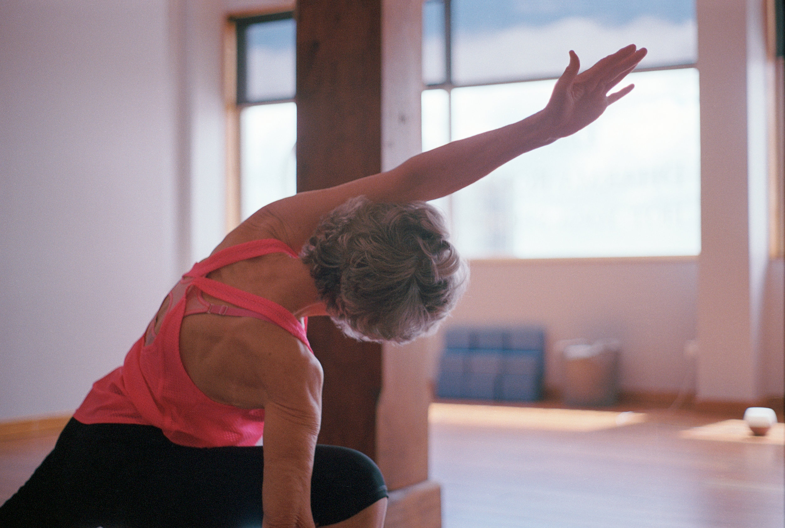 Judy Carmichael practicing yoga at the studio