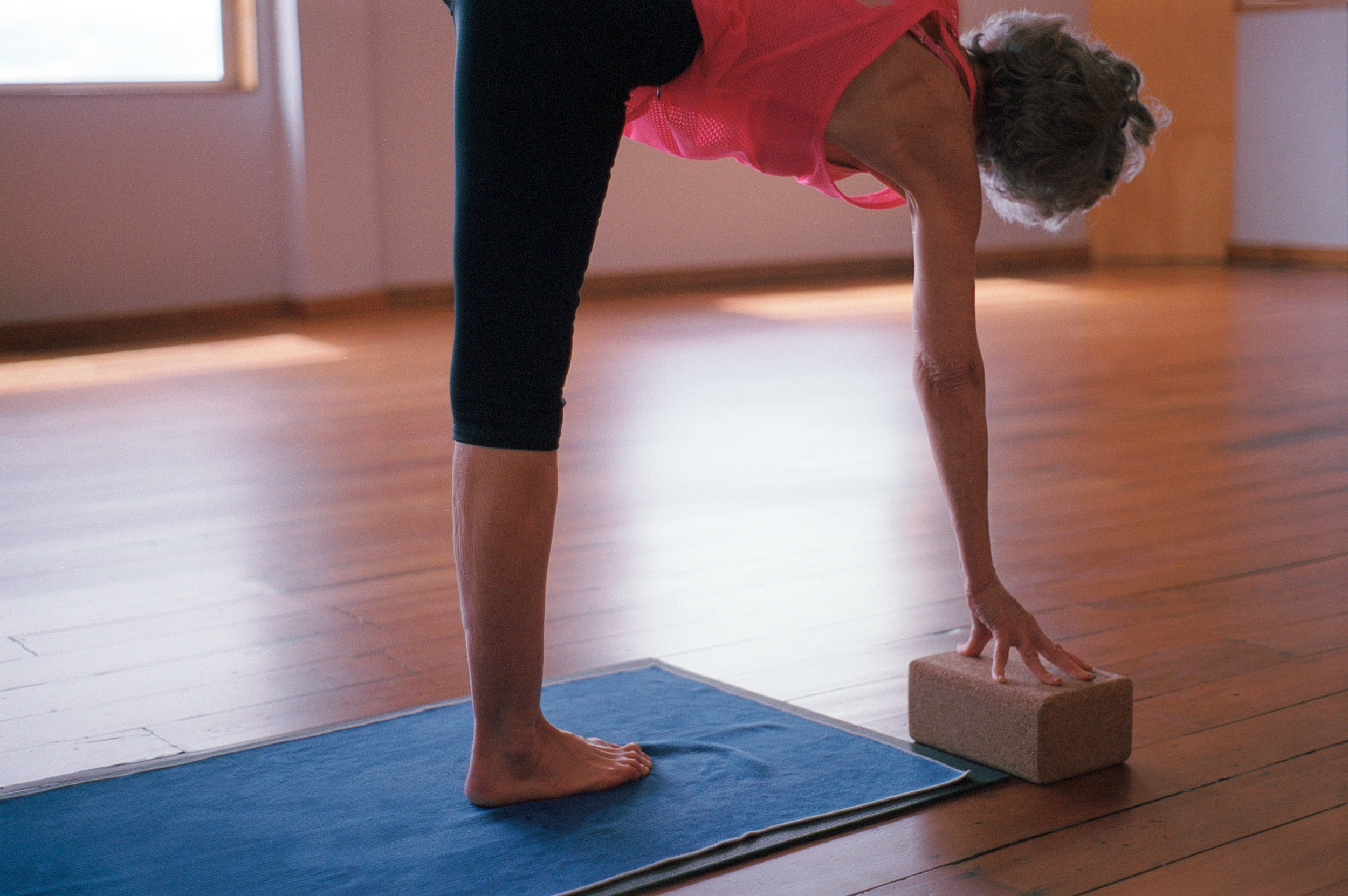 Judy Carmichael practicing yoga at the Dharma Room