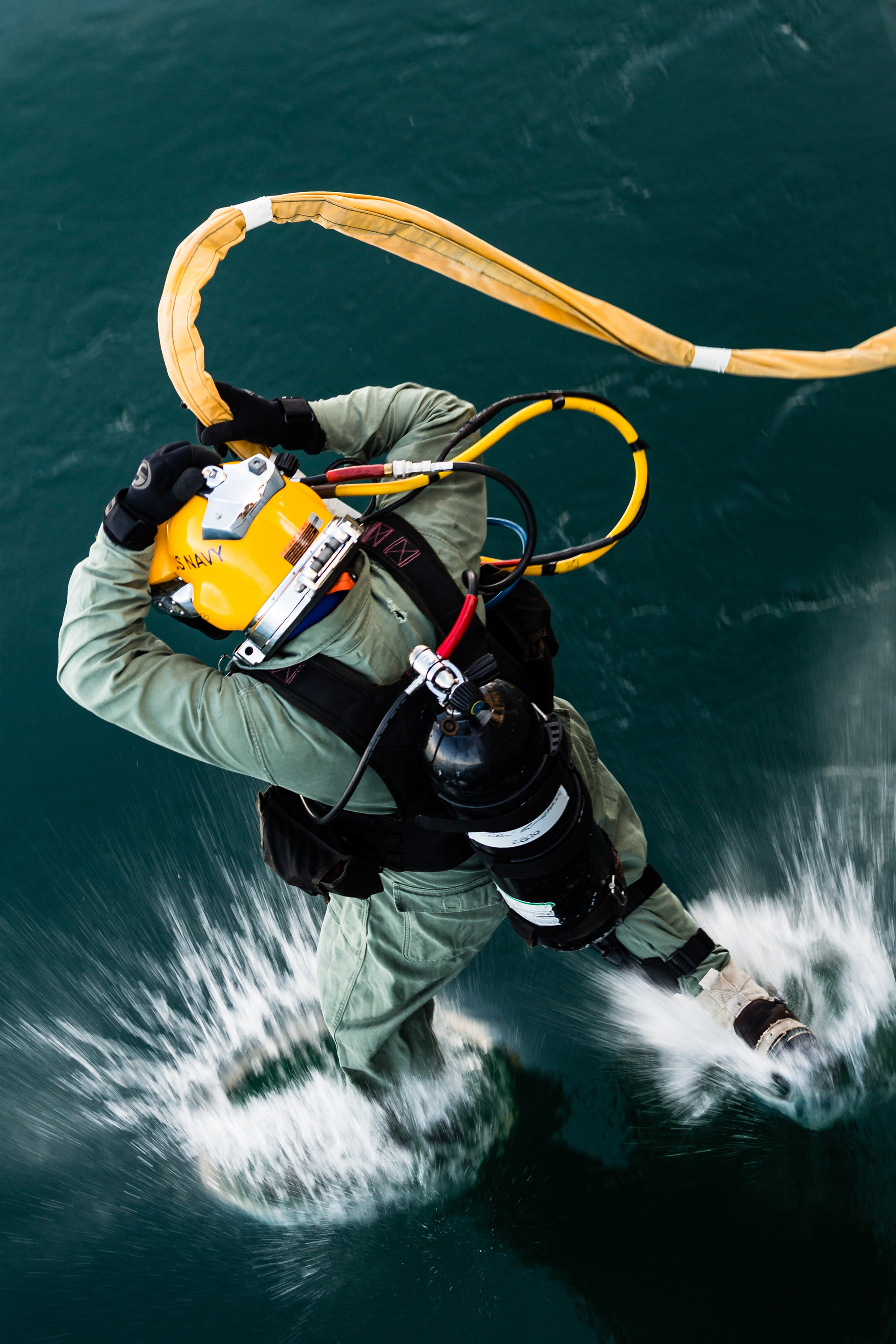 navy diver jumping into the water