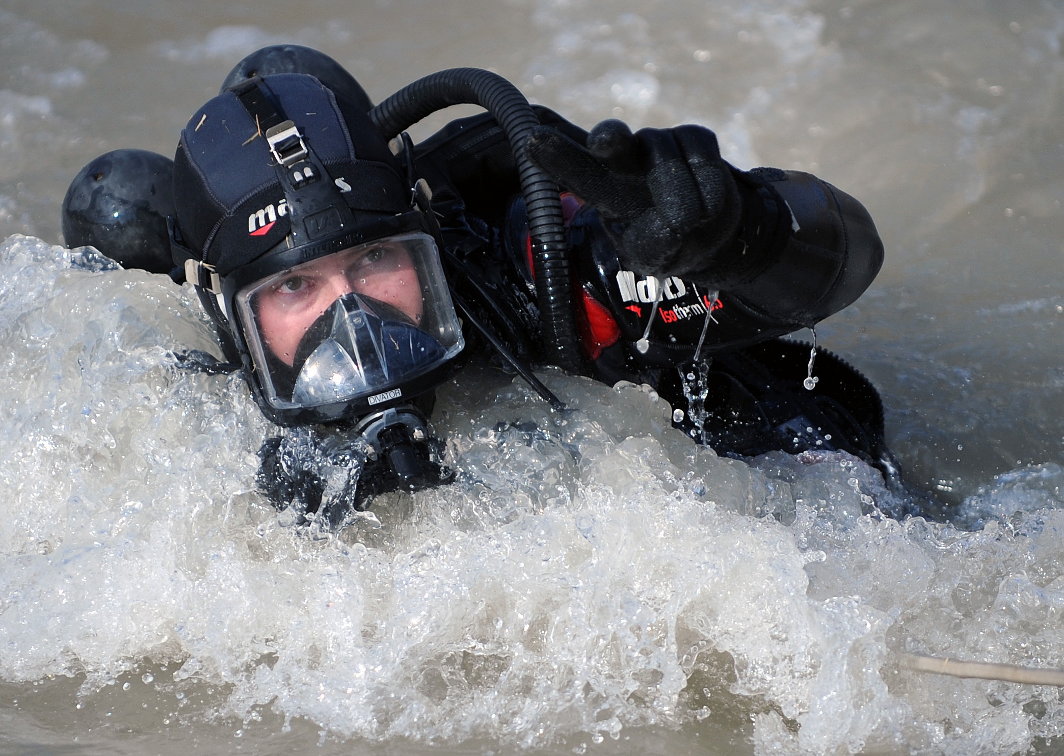 Navy diver coming out of the water wearing mask