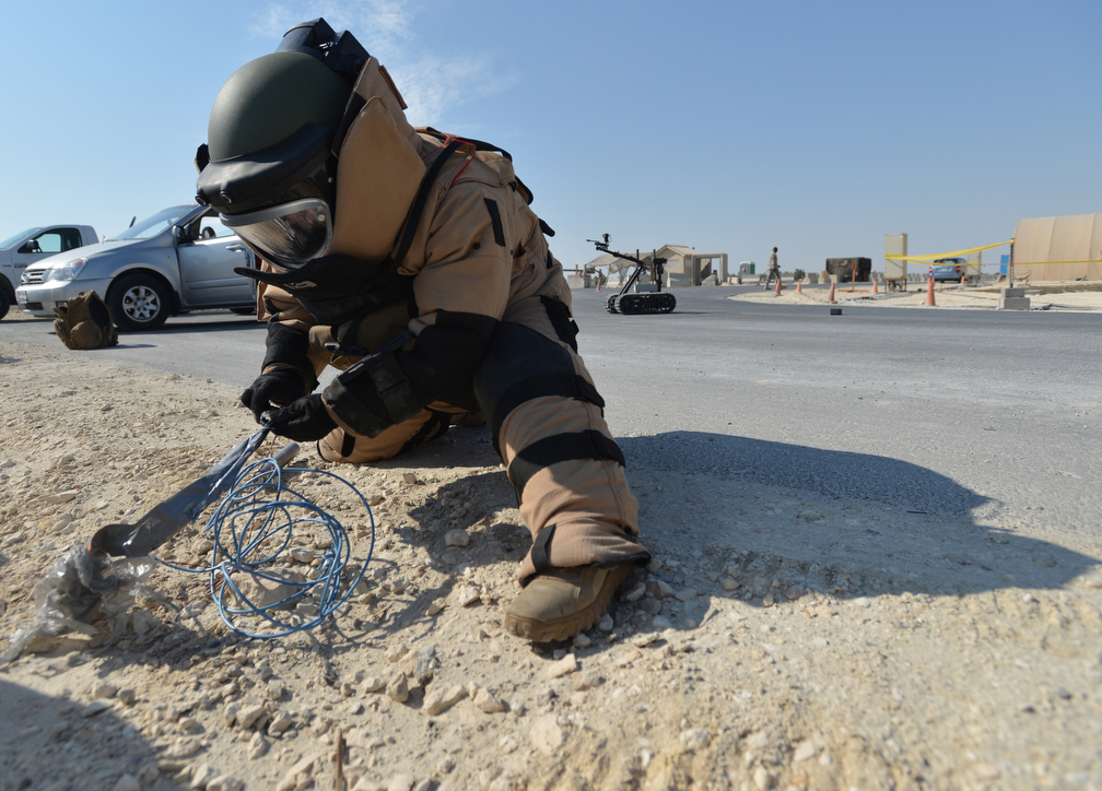 EOD technician working on wires