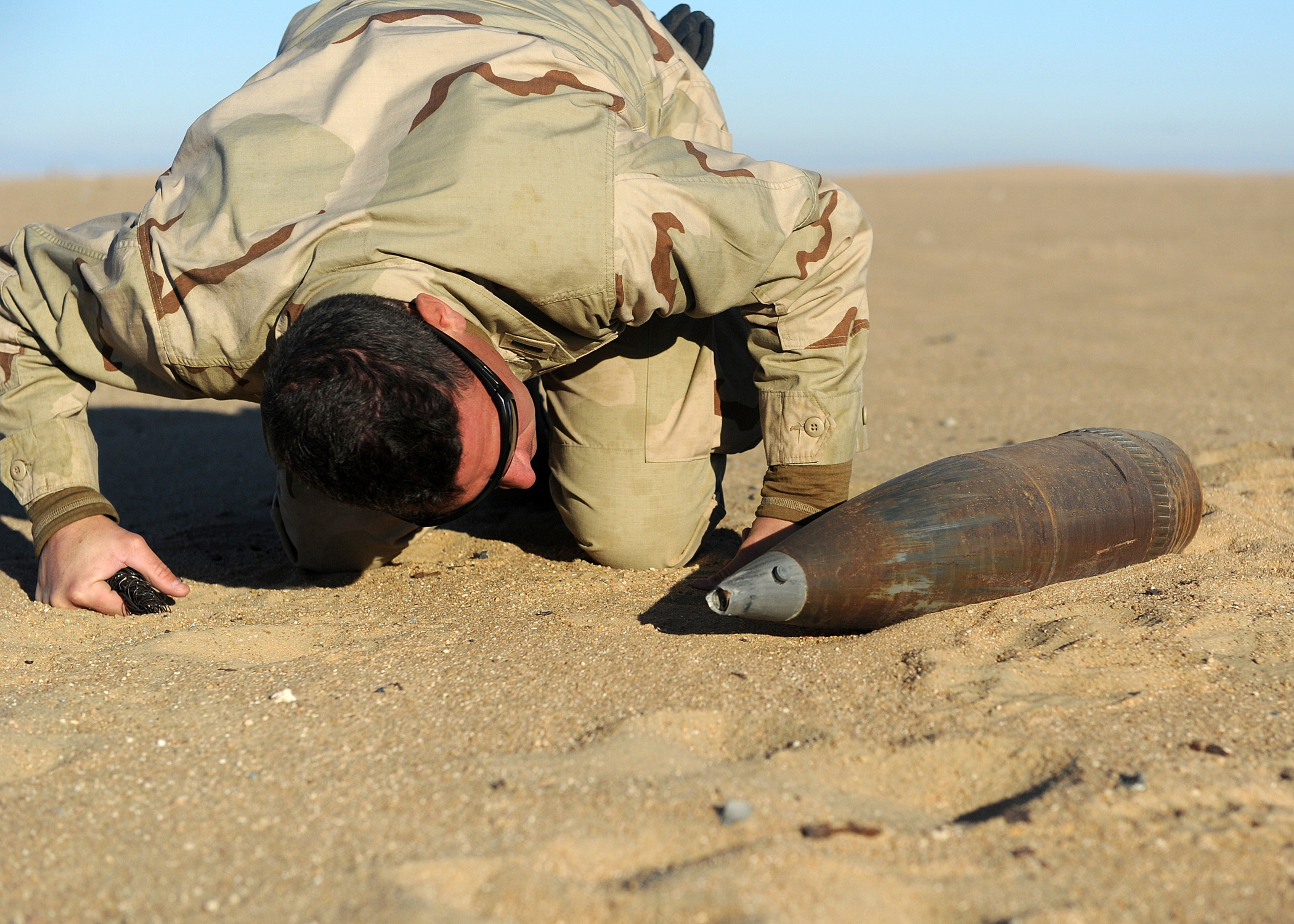 EOD technician investigating aged EOD