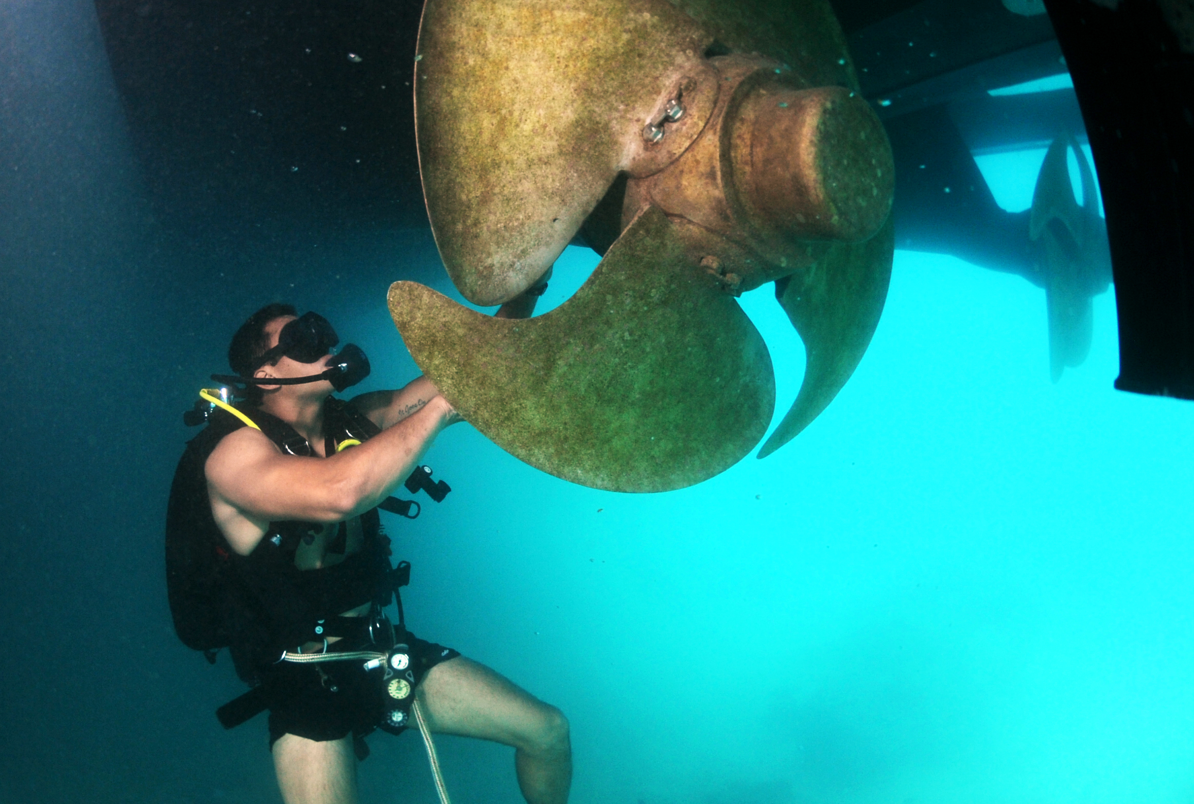 navy diver fixing ship propeller
