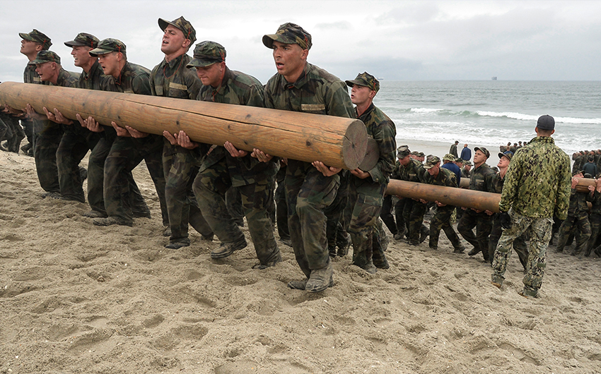 SEALS in bootcamp training with heavy logs