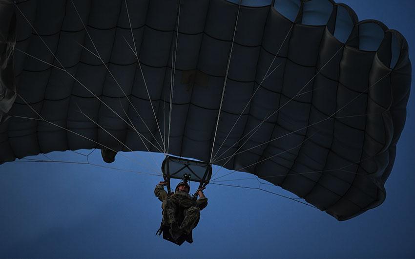 Special warfare combatant crewman parachuting in