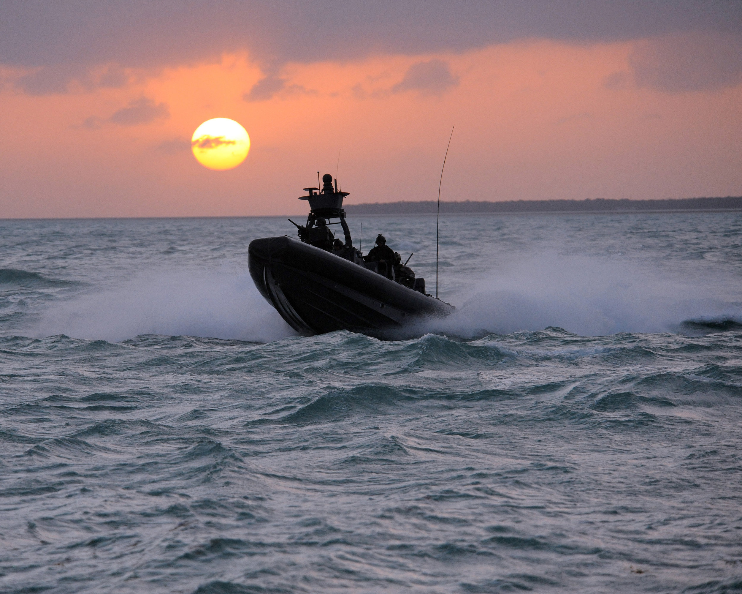 SWCC boat on the waves at sunset