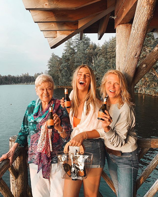 Three generations in one photo: grandma, mama, and me! 👵🏼👩🏼👧🏼 Ain't we CAYOOT?! 🥰 I got to spend some time with the fam in the Adirondacks recently, and I surprised em with the cutest lil six pack ever of  @RuffinoWines Prosecco 🍾 . We sipped a lil bubbly as we watched the sun go down on St. Regis lake... and as I got bitten by a million mosquitos 😫 Why do they love me so much?! . Swipe up in my stories to snag your six pack, because it's national prosecco day tomorrow yallz! #RuffinoFam #RuffinoPartner, #For21+