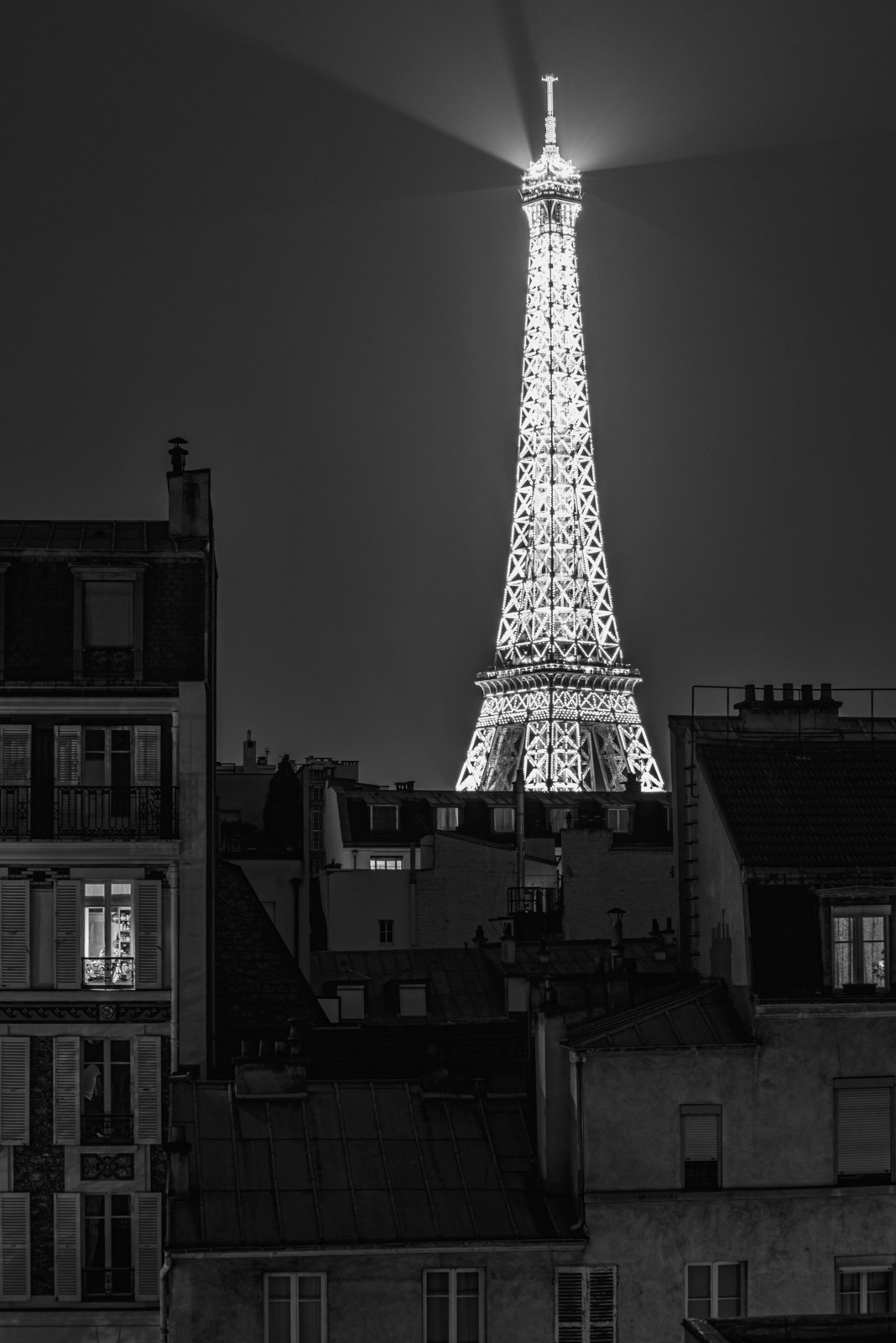 TOUR EIFFEL, LOOKING OUT A NEIGHBORHOOD WINDOW