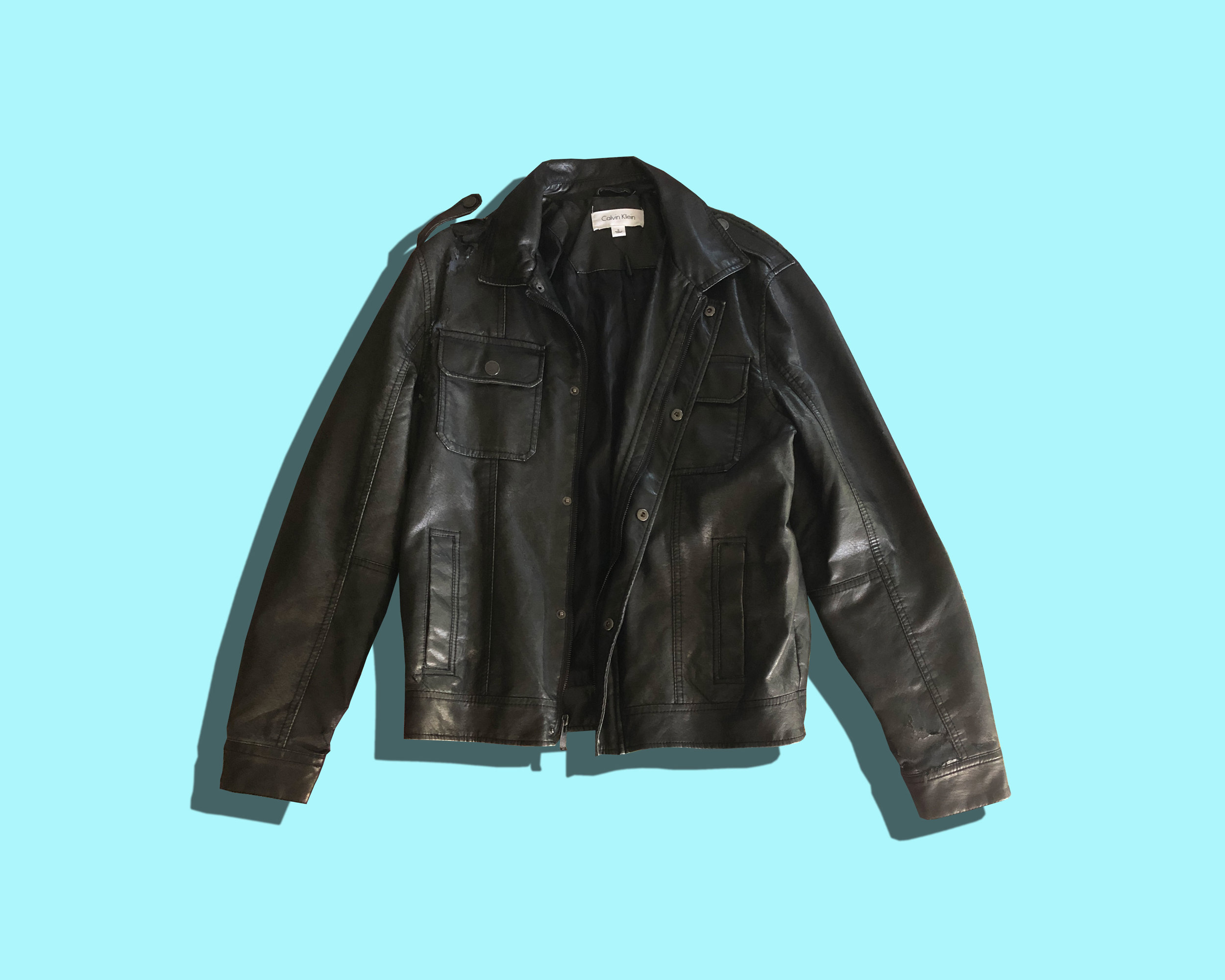 jacket deconstruction - The back of my faux-leather thrift store jacket is peeling off, so I decided to cut away the good material and make something new out of it.(in progress)