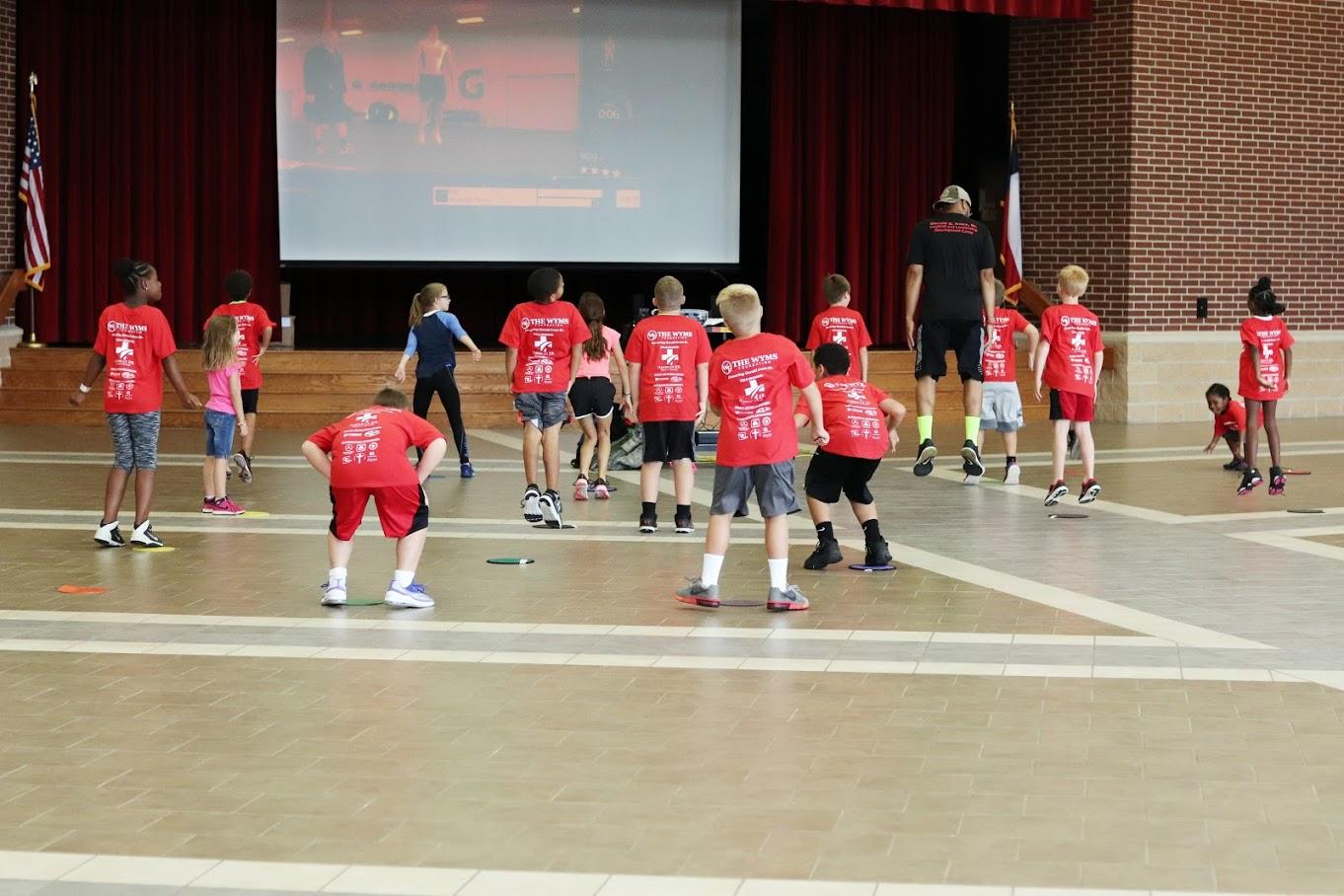 kids doing JJ Watt fitness drills.jpg