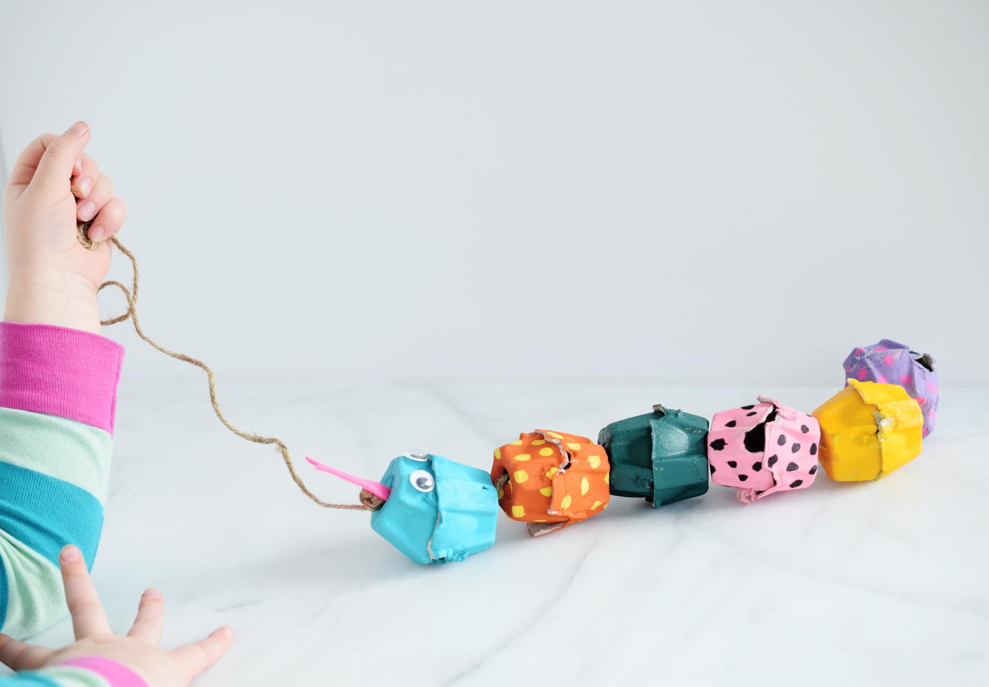 Egg Carton Snake Craft - toddler playing with craft