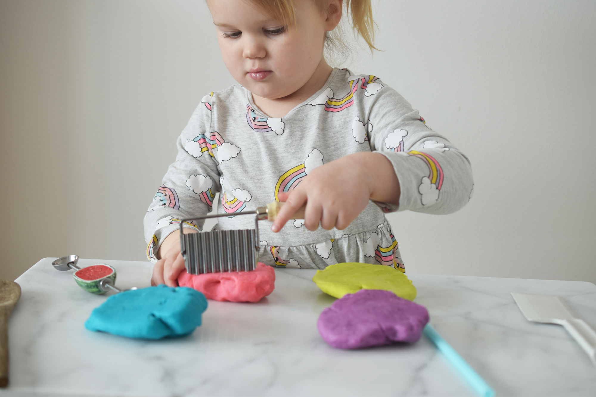 toddler playing with homemade playdough