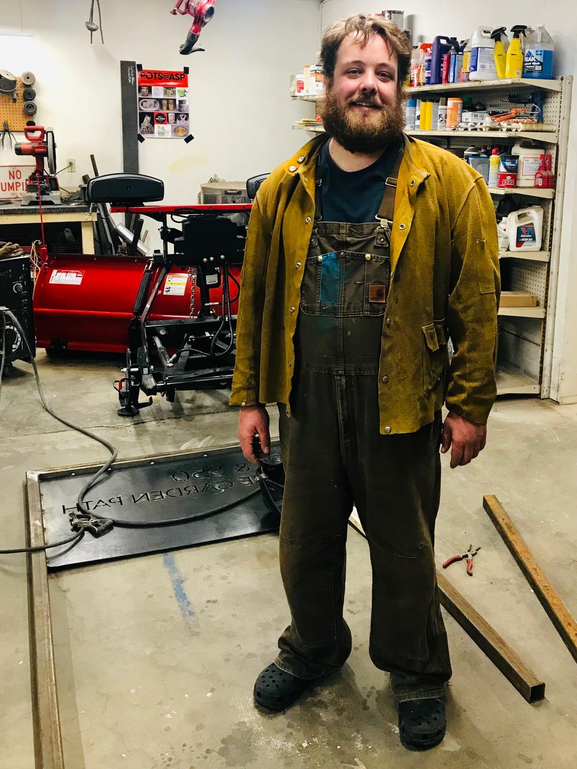 Ben Craigie in his studio working on a metal sign.