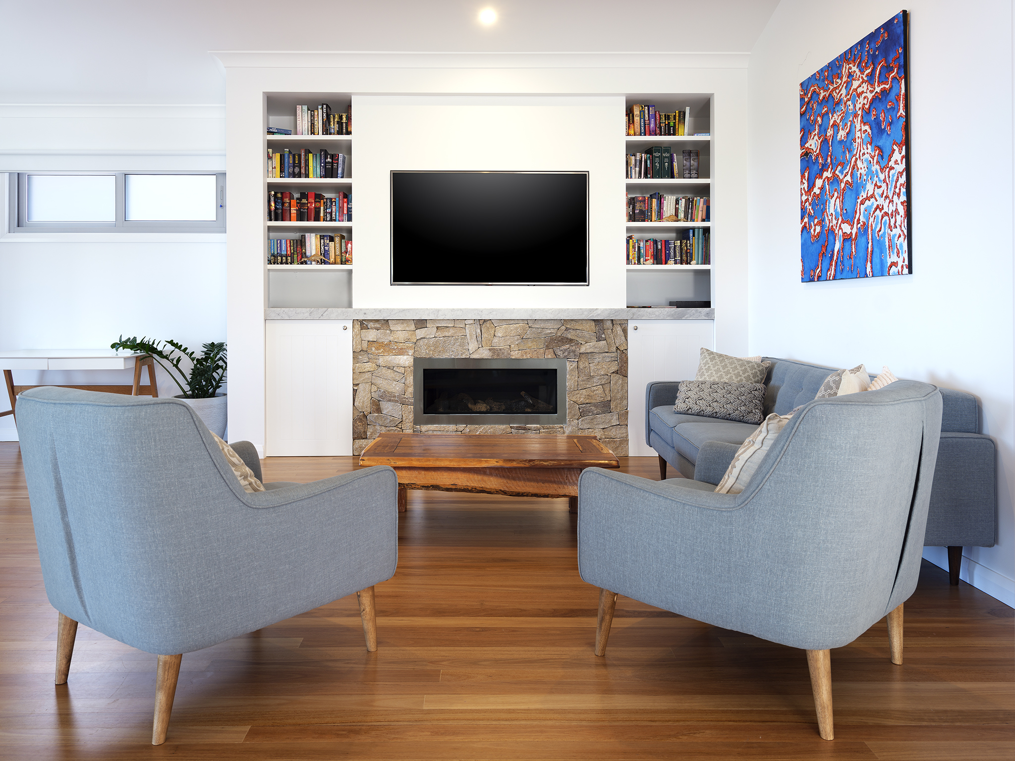 Loungeroom sitting room library new build renovation extension killcare central coast gas fire stone cladding marble mantle.jpg