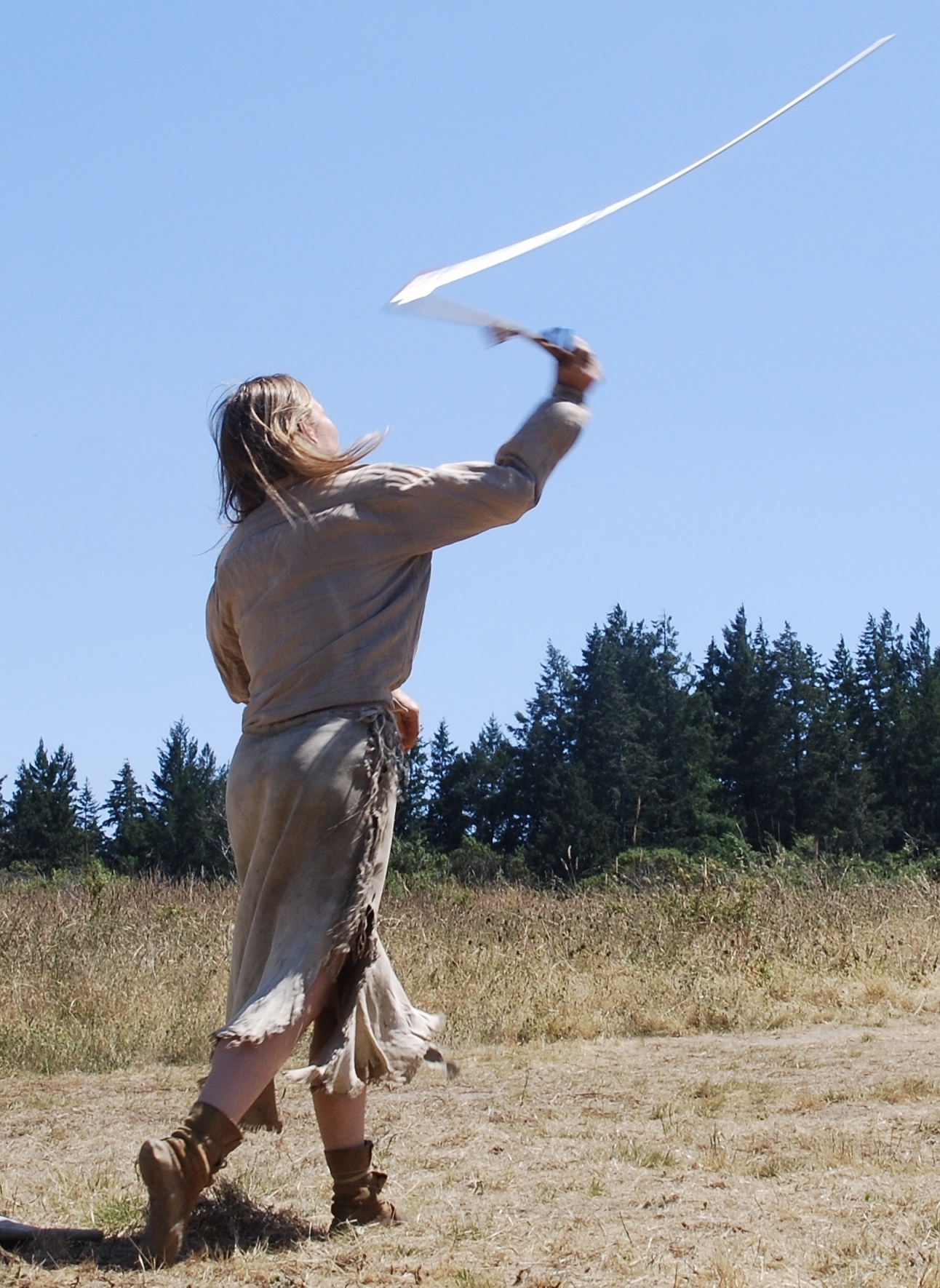 Atlatl in motion. The dart is about to fly away from the thrower.
