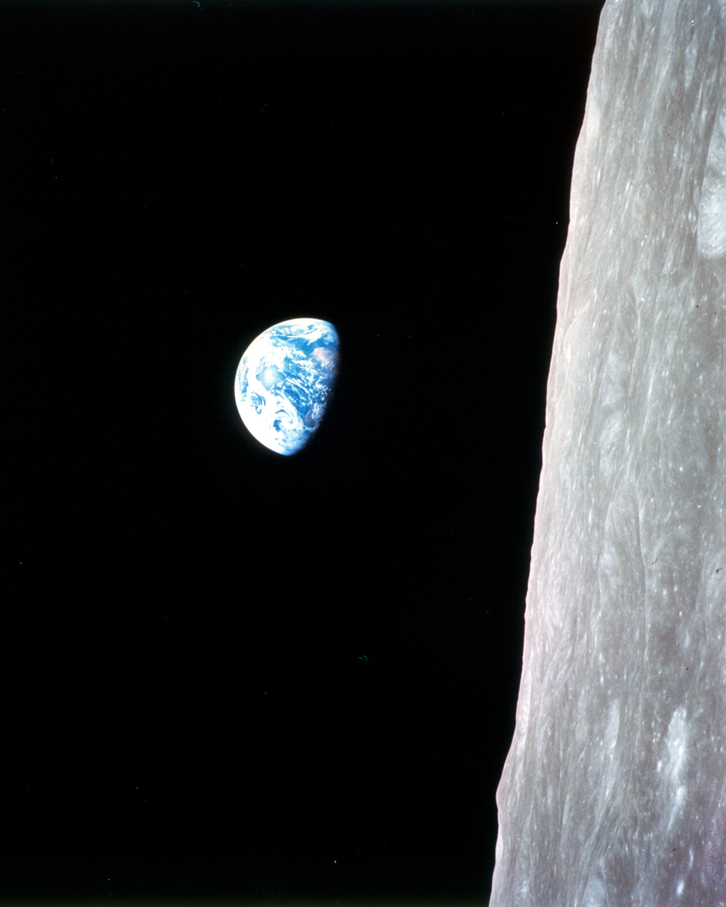 This iconic photo of the Earth rising above the Moon was taken by  William Anders  on the Apollo 8 mission, 50 years ago, on December 24, 1968.  Credit:  NASA . Like others from NASA, the photo is in the public domain without copyright protections.