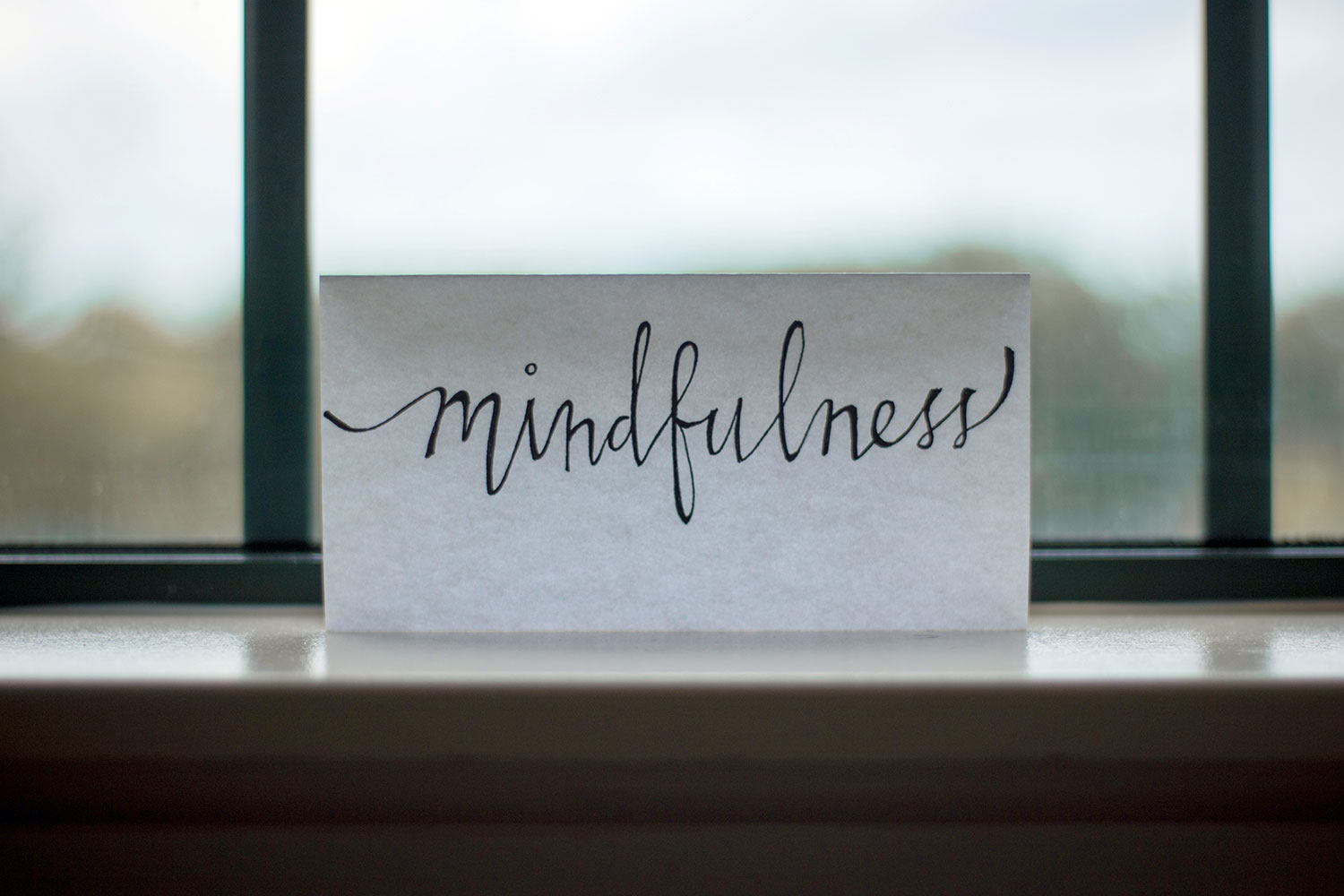 photo of paper placed in window with mindfulness written on it to represent and introduction to mindfulness course in gloucestershire.jpg
