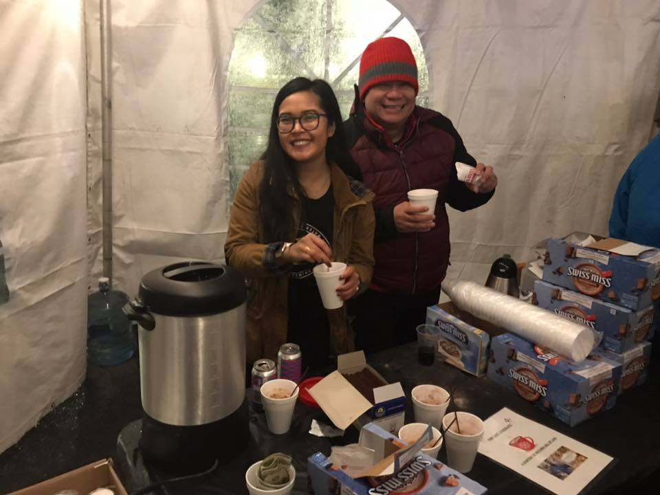 Cinda serving hot coco at Lynn's First Night celebration with Coco Alinsug.
