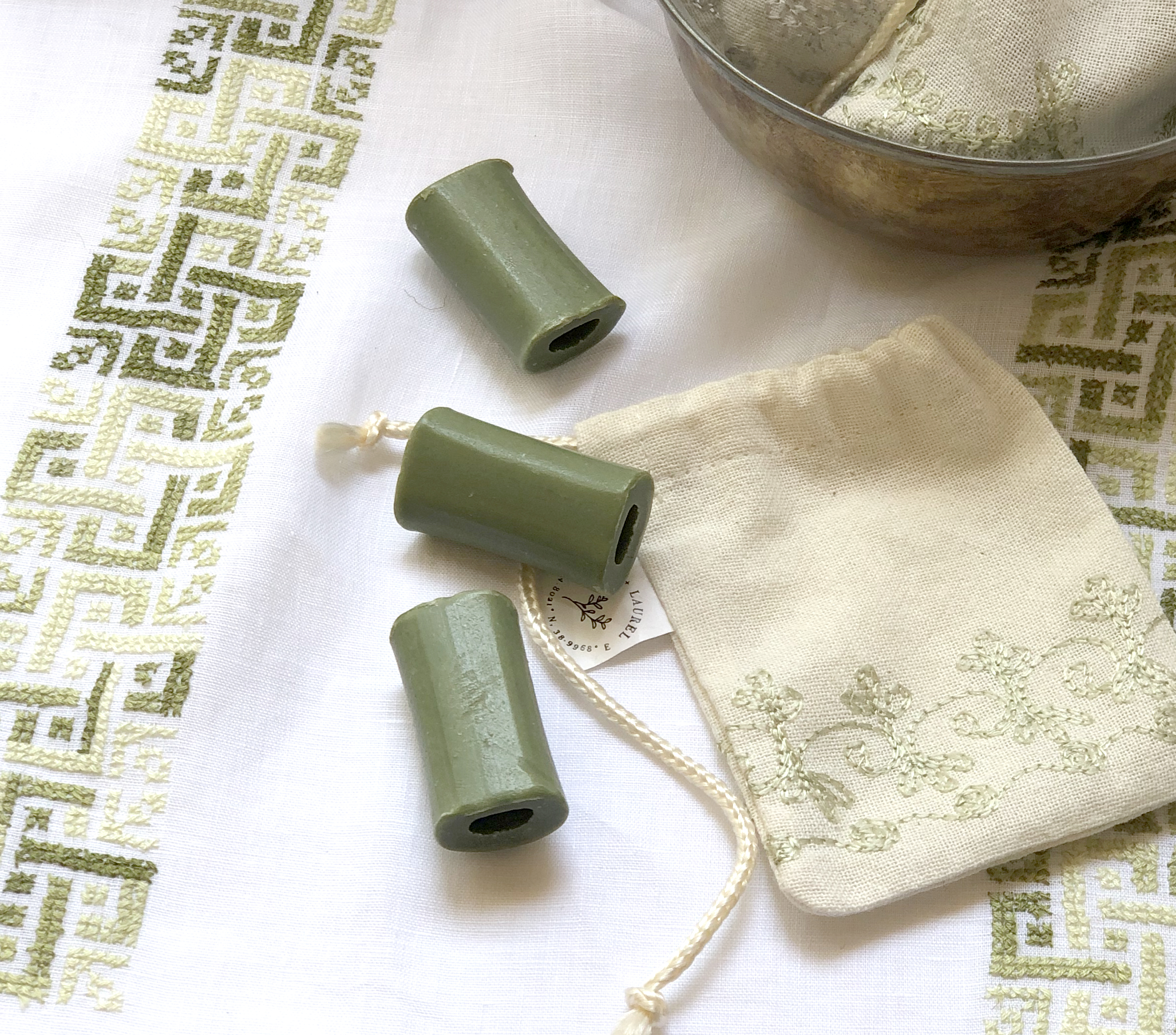 """Mini Fragrance Pouches - I got these beautiful handmade pouches, with the mini laurel soap tubes, as favors for my baby shower. They smelled refreshing, crisp and clean, like you've just taken a bath. The smell lasts a very long time which is great. I kept a few for myself, and use them at home in my satin drawer and in my car!""""-MAECE S., SEAL BEACH, CA."""
