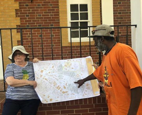 Canvassers from the Greenspon Center plan flyer distribution to invite Grier Heights residents to attend a Housing Partnership event to elicit community input for the upcoming development.