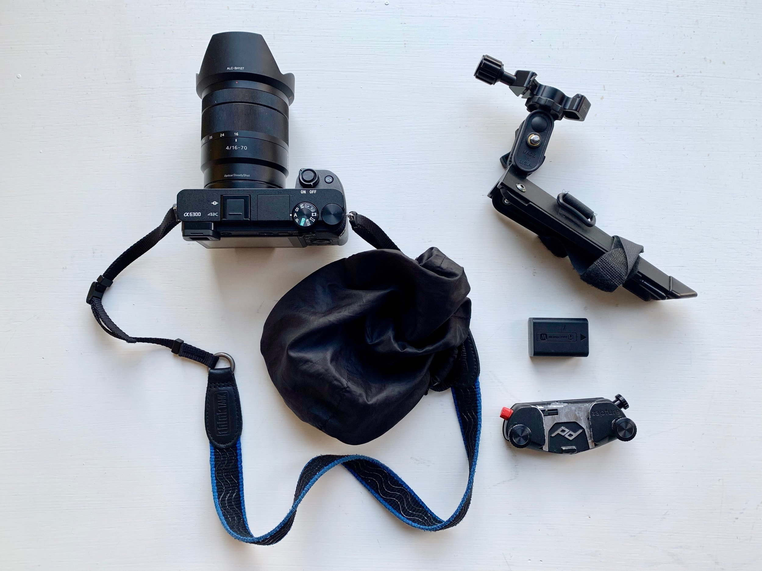 Sony A6300 with Thinktank strap, camera cover, Pedco Ultrapod II tripod, spare battery, and Capture Camera Clip to store the camera near my shoulder