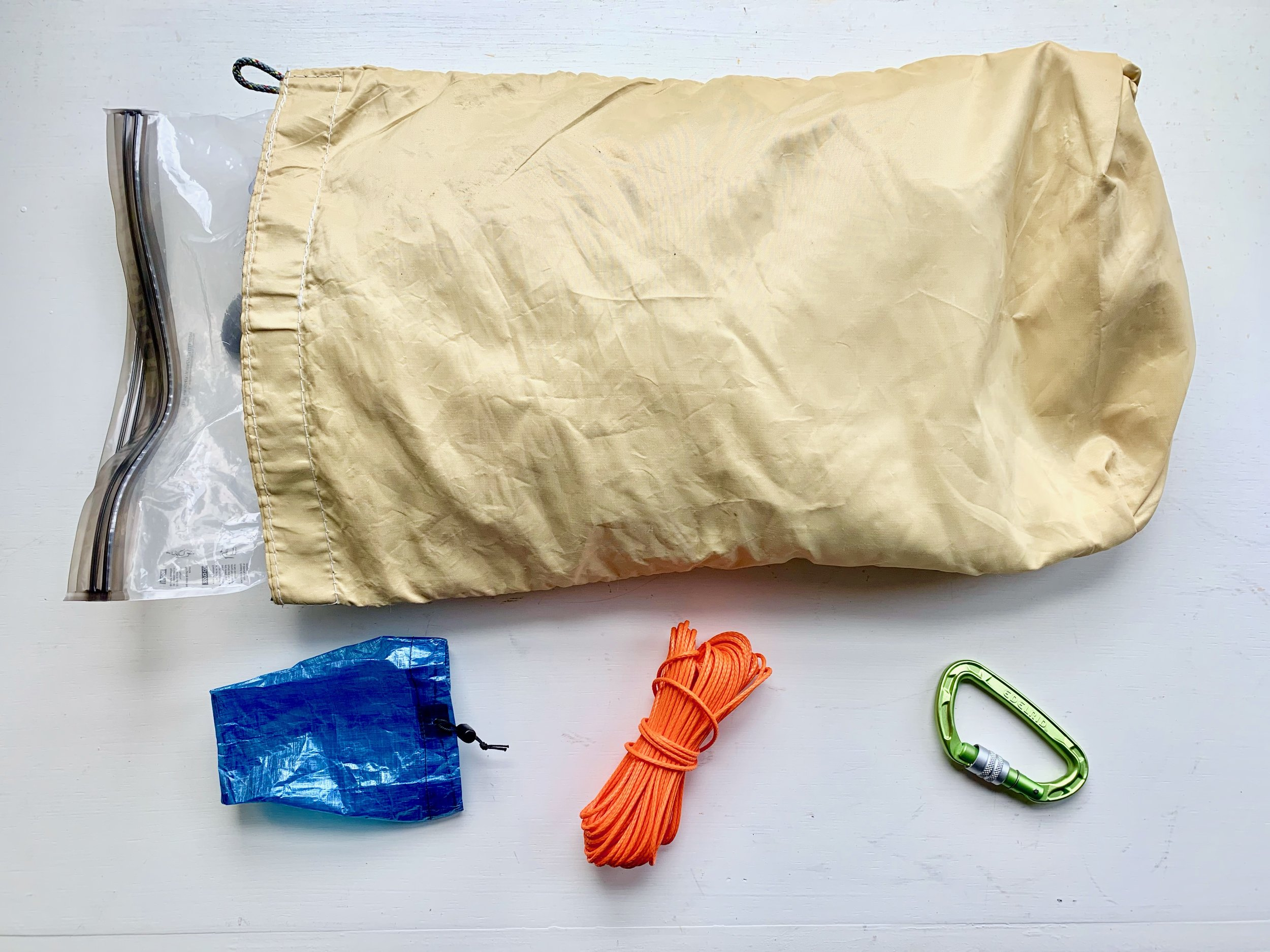 Protecting food without a canister:  Hang it in a tree. Odor-proof Opsak stuffed into a rodent-chew-proof Ursack Minor. Small rock sack, slick cord, and carabiner for hanging.