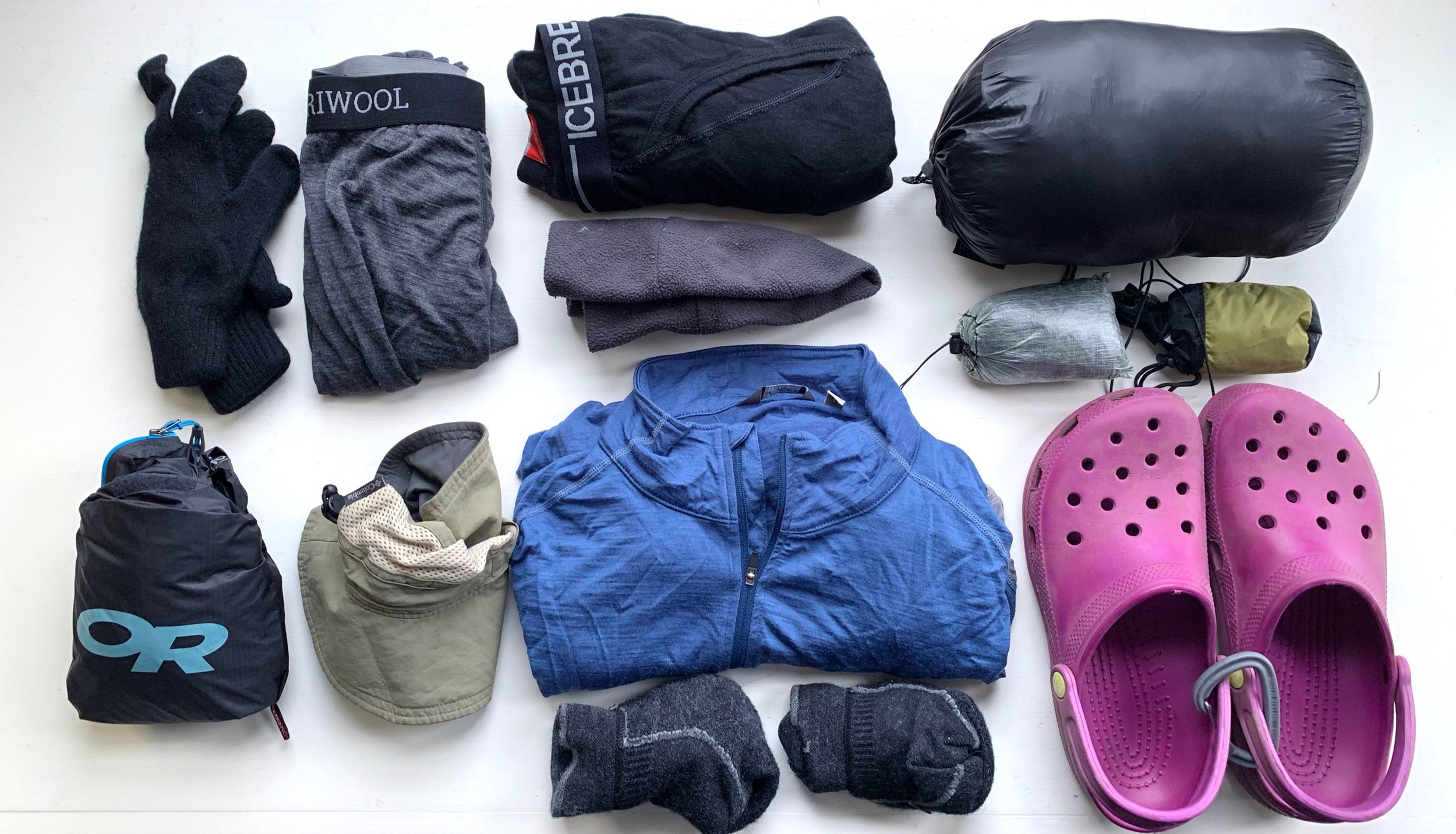 Packed clothing : Zpacks Possumdown gloves, Meriwool underwear, Icebreaker wool leggings, cap, Montbell down jacket, rain kilt, bug net, Outdoor Research rain jacket, hat, mid-layer pullover, extra Darn Tough hiking socks, and crocs for camping and river crossing.
