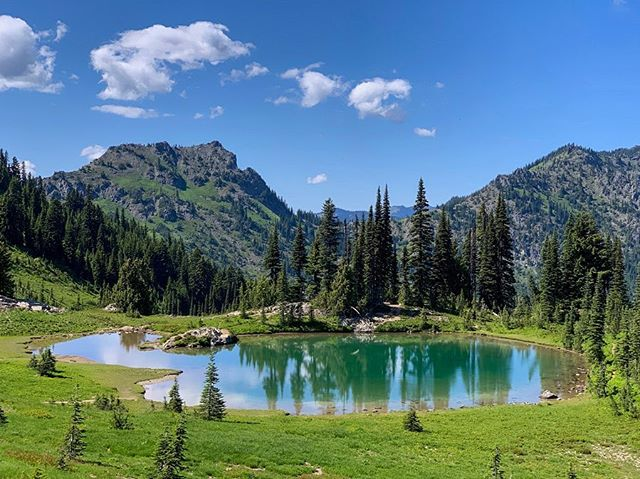 """Washington continues to amaze. Loads of evergreen forest🌲, lakes💧, and alpine views here. 🏔  I hiked 11.25 days without a rest day covering the southern half of the state, 248 miles and 47,000ft elevation gain. I'm tired! I've heard the northern half ahead has more challenging terrain.  I'm enjoying a rest day at Snoqualmie Pass. The legend of Triple Whammy continues with my eating habits. 🥘 🥘 🥘 In 26 hours in town I've eaten a 3 egg omelet, 2 pancakes, 2 pizza slices, 2 cheeseburgers with avocado, fruit smoothie, quinoa salad, 2 orders of French fries, teriyaki chicken and rice bowl, Cheetos and Bugles platter, hot dog with chips, and 6 beers (which have critical nutrients!). Remembering the skills learned in the desert portion of the PCT, I'm also packing out pizza tomorrow in my backpack! 🍕  While the scenery has been incredible, It's been a challenging time. My feet have been hurting. I pushed hard after time off the trail. I'm also missing family and friends back home.  The next section (Snoqualmie Pass to Stevens Pass) has been described to me by someone as """"the hardest hiking they've ever done"""" and by someone else as """"their favorite hiking they've ever done."""" I'm intrigued. I'll find out tomorrow! 👣  #pct2019 #pct #pcta #pctig #mexicotocanada #trekthepct #cascademountains"""