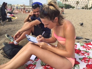(I definitely felt powerful when I helped lock up a thief! This is me signing the paperwork with an undercover cop to throw the Barça Beach Bandit - aptly named by my friend Erin - in the slammer!)