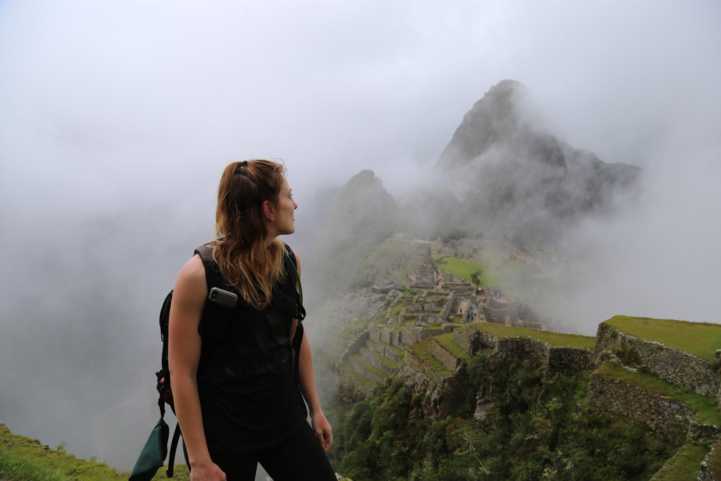 Machu Picchu covered in fog.