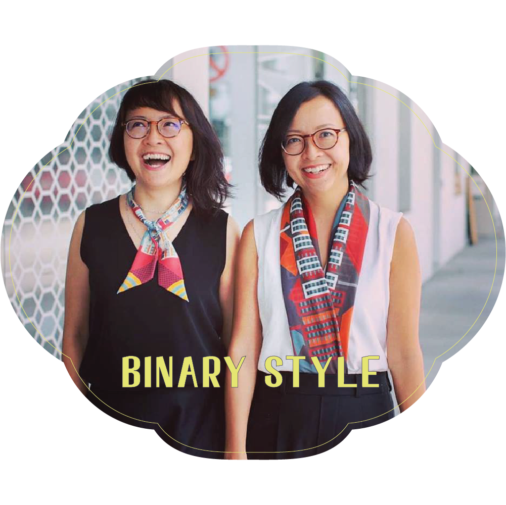 Tung On Wui Kun x Binary Style x SCENE SHANG  Founded by twin sister designers, Santhi and Sari Tunas, Binary Style uses scarves as a medium to narrate the Singapore story. Featuring vivid colours and original prints, Binary Style captures the essence of Southeast Asia and the biodiversity of Singapore in their designs. Binary Style is proud to have worked with the likes of National Heritage Board and Singapore Airlines.   Installation:  For The Love Of Opera    For The Love Of Opera  is a collaborative installation between Binary Style and SCENE SHANG. Inspired by Tung On Wui Kun's reputation and passion for Cantonese opera, this installation draws on elements of local culture and uses scarves and furniture to reflect the vibrant Cantonese opera troupe culture of Tung On's heyday.