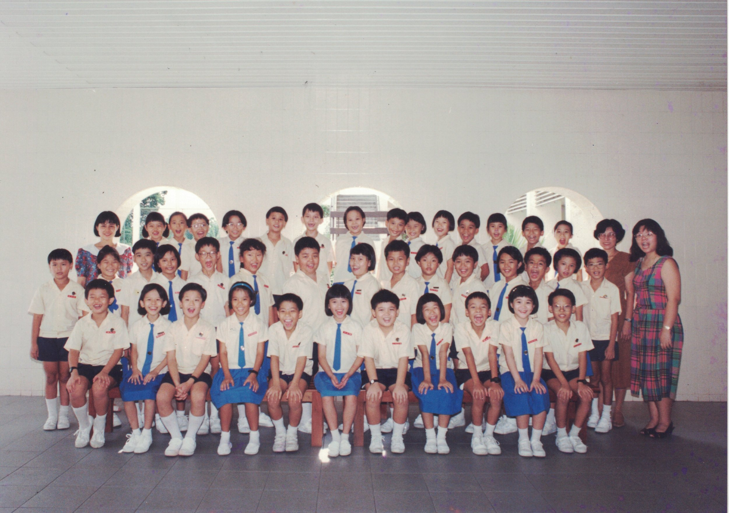 An old class photo. Ryan is in the first row, fifth from the left. Melvin, also in the same row, is the first from the right.