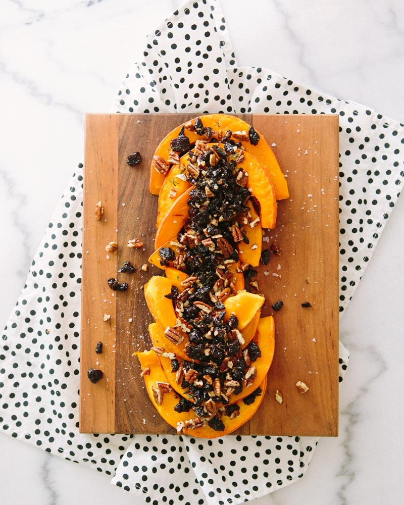 Roasted Red Kuri Squash + Tart Cherries - Roasted red kuri squash topped with tart dried cherries that've been sautéed in butter with rosemary and then mixed with pecans… THIS is heaven on a plate.