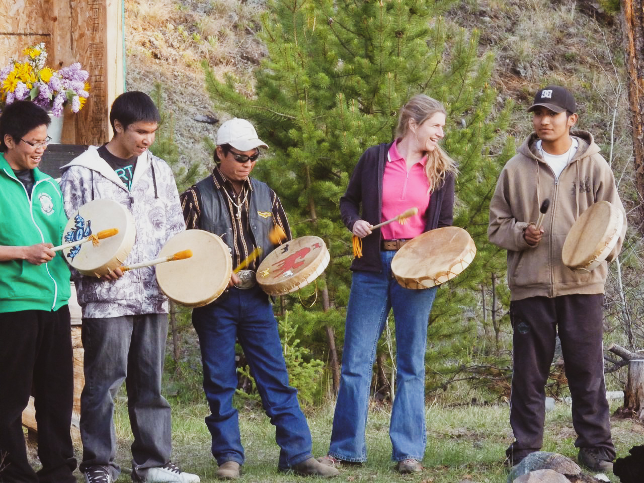 Shari drumming with group.jpg