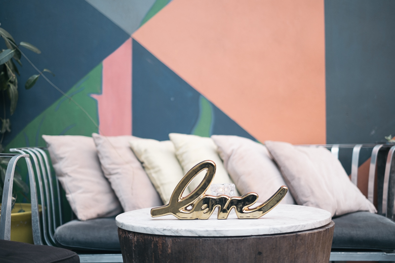 eniola and lumi wedding with cluster events love sign.jpg