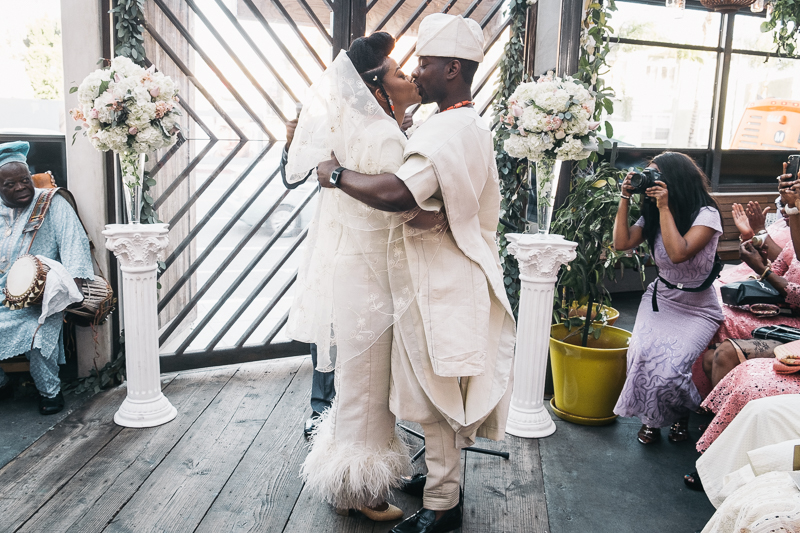eniola and lumi wedding with cluster events white dress.jpg
