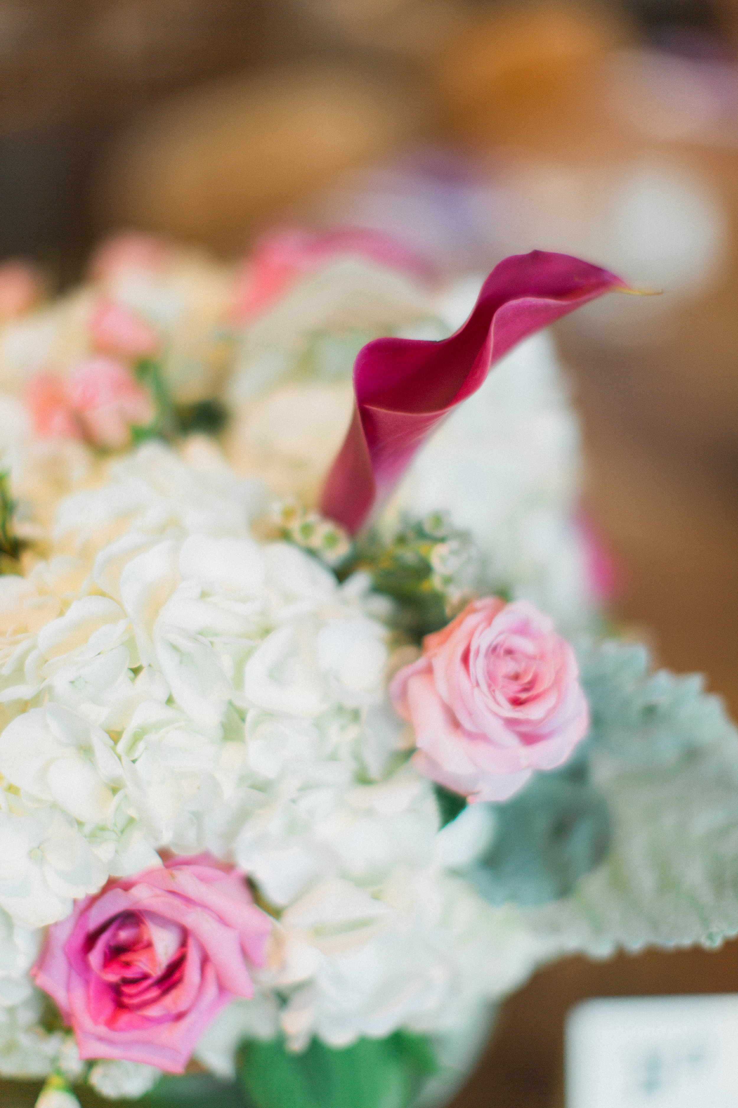 melissa and bill wedding with cluster events floral agains.jpg